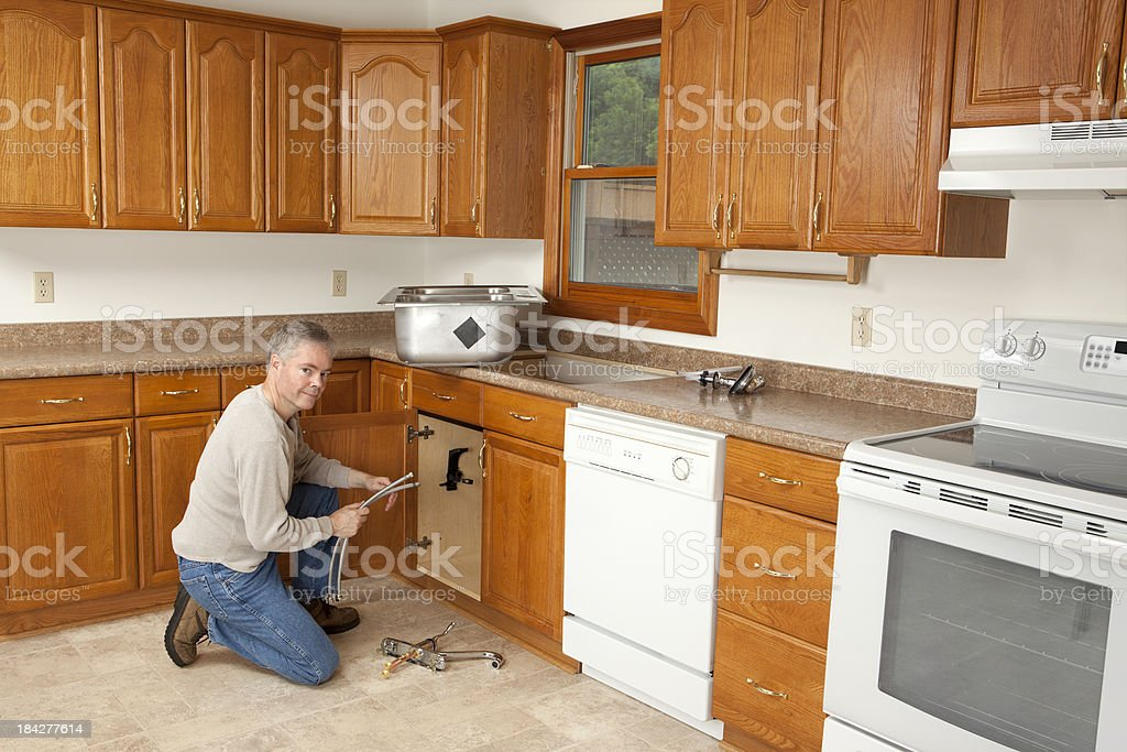 Man Installing New Kitchen Sink royalty-free stock photo
