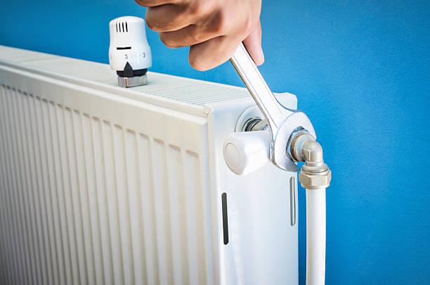 Man installing radiator valve close up