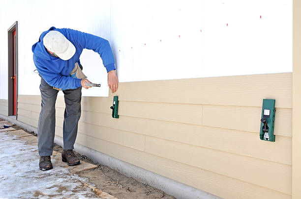 Man installing siding stock photo
