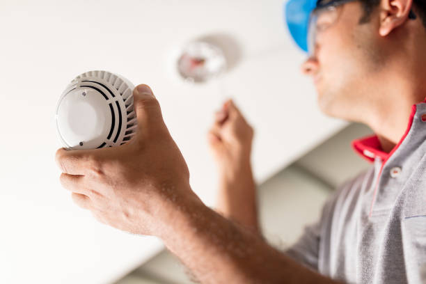 man installing smoke detector - alarm stock pictures, royalty-free photos & images