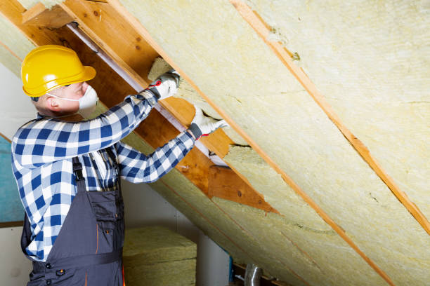 Man installing thermal roof insulation layer - using mineral wool panels. Attic renovation and insulation concept Man installing thermal roof insulation layer - using mineral wool panels. Attic renovation and insulation concept attic stock pictures, royalty-free photos & images