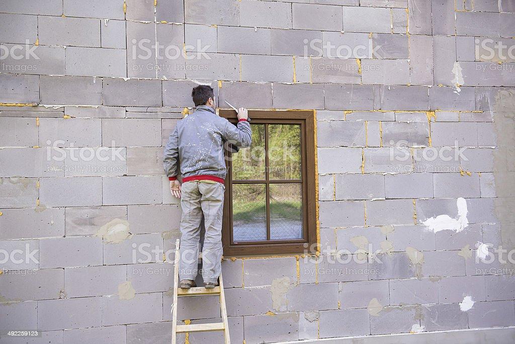 Man insulating windows stock photo