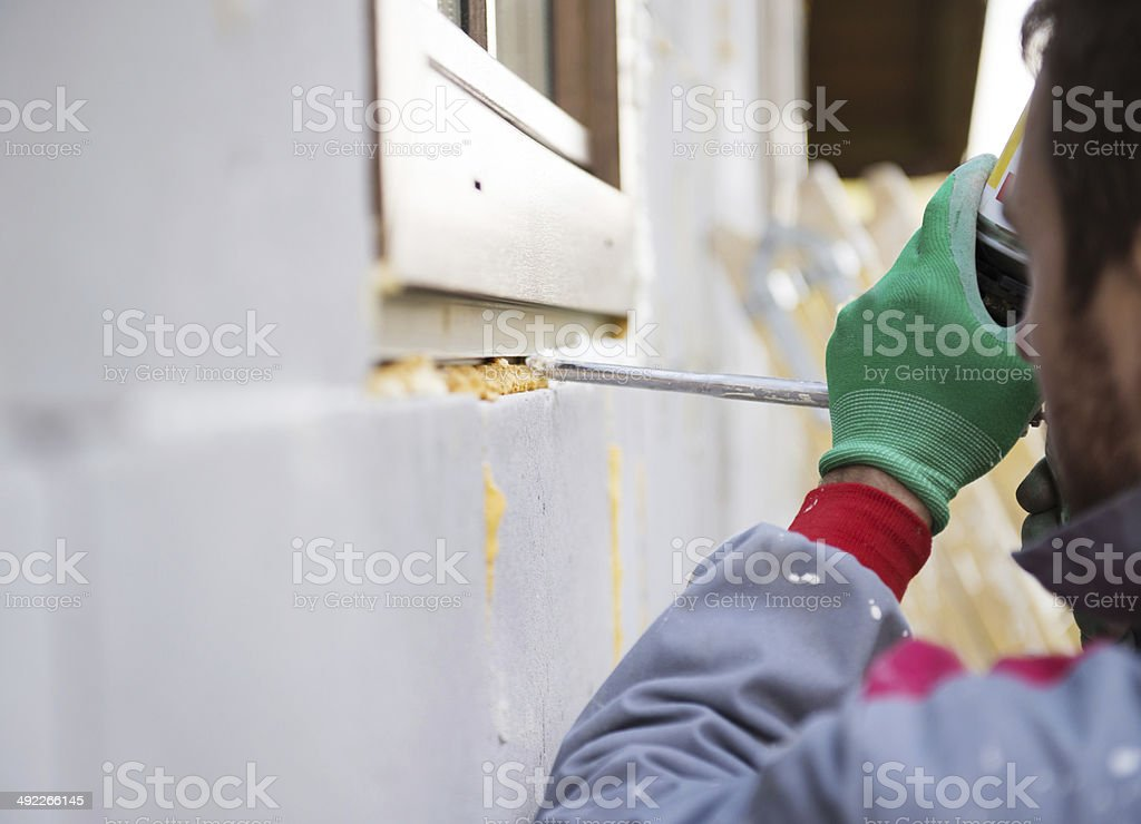 Man insulating windows stock photo