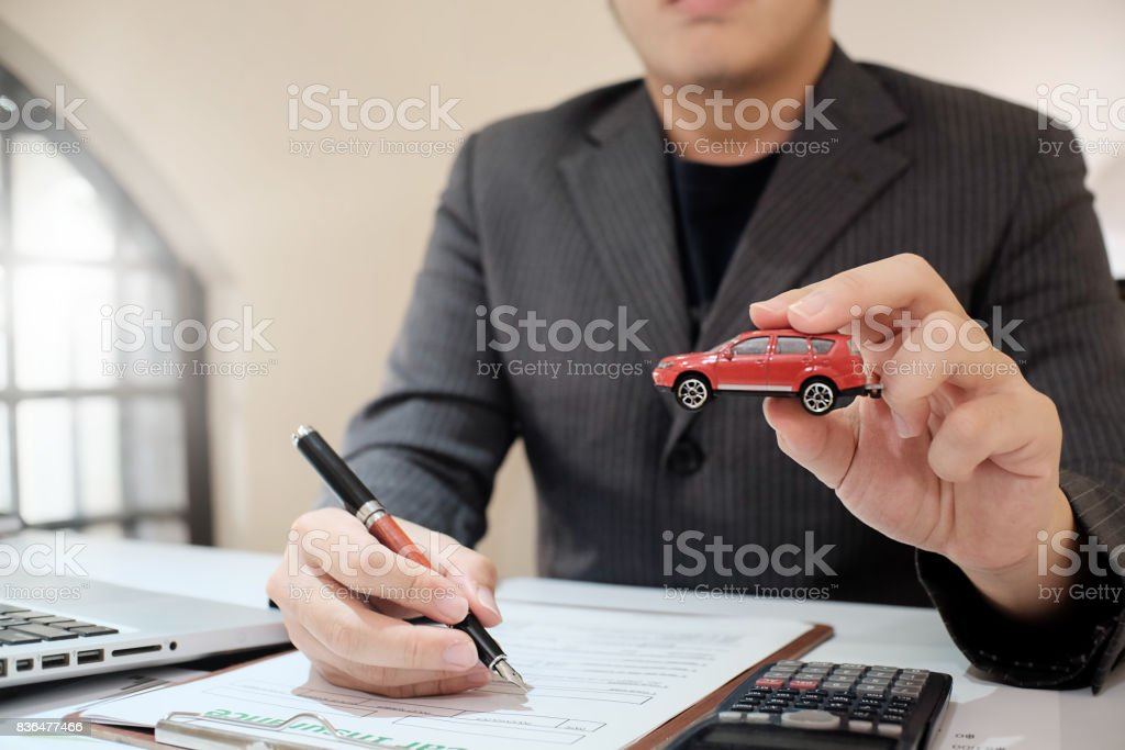 A Man Insurance broker offer protect your car , Insurance auto car concept and Insurance reimbursement vehicle Concept stock photo