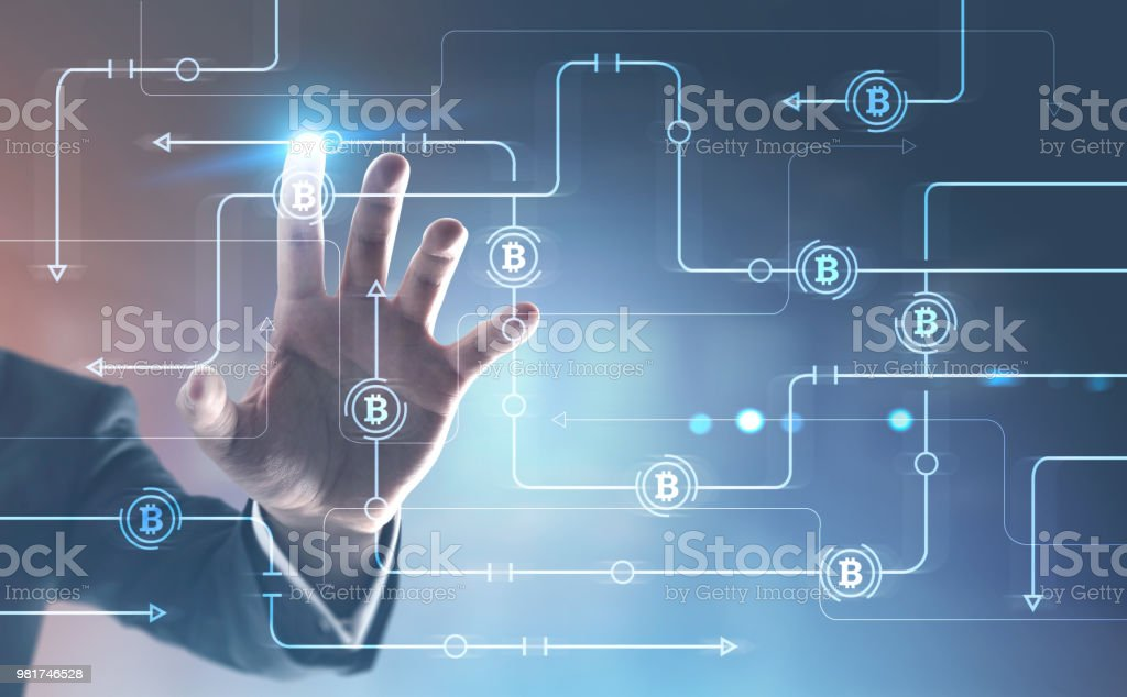 Man interacting with bitcoin immersive interface stock photo