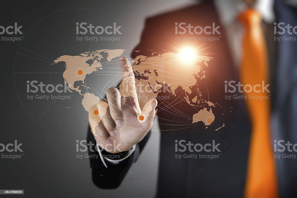 Man interacting with virtual world map stock photo