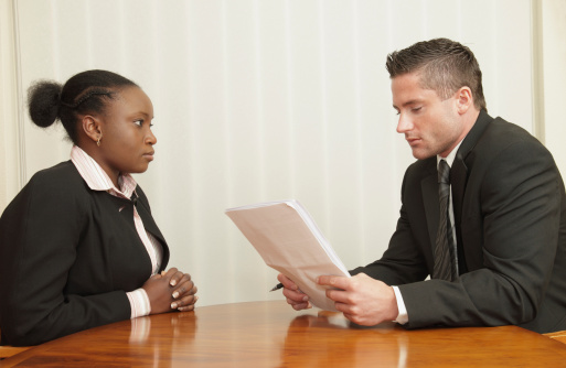 Man Interviewing Woman Stock Photo - Download Image Now