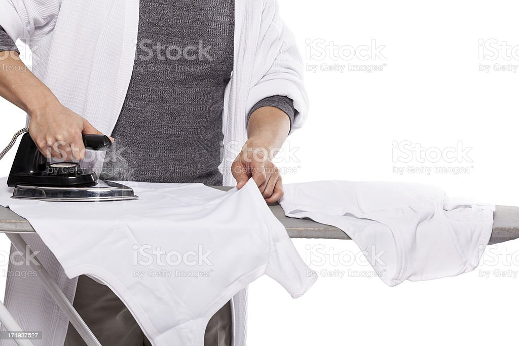 Man ironing his underwear stock photo