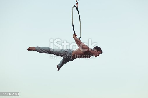 istock Man is an acrobat high in the sky. 871972260