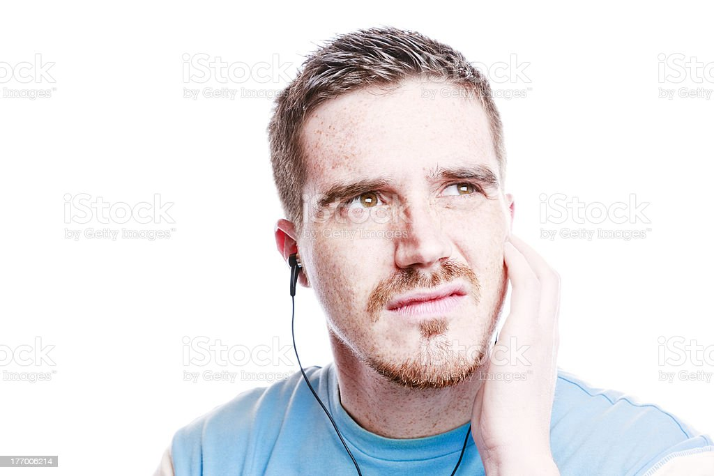 Man is Annoyed by Bad Music royalty-free stock photo