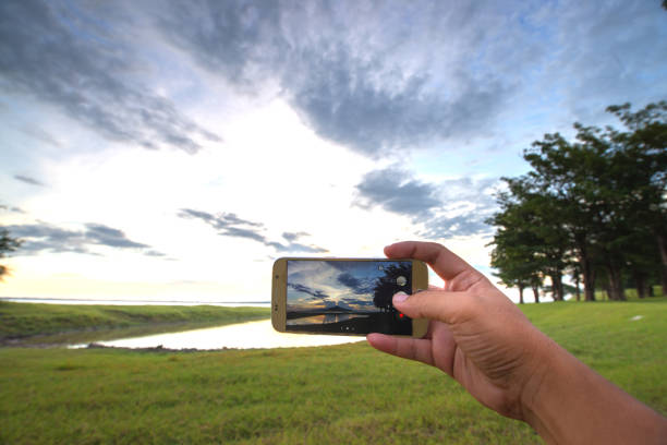 man is capture landscape. - photo messaging stock photos and pictures