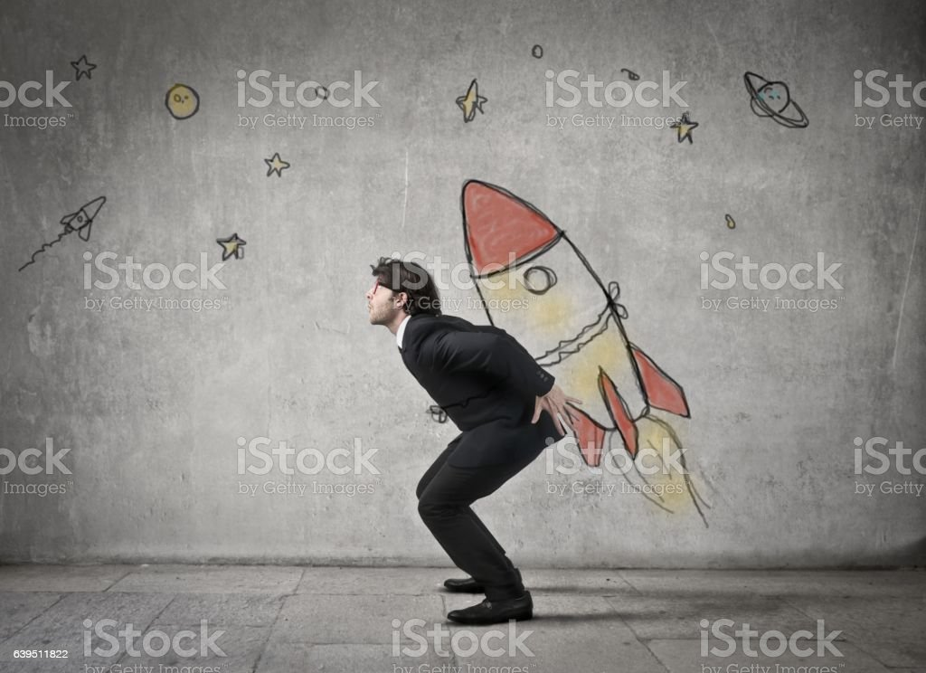 Man is carrying a rocket stock photo