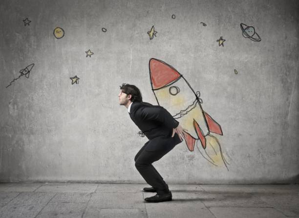 man is carrying a rocket - beginnings stock photos and pictures