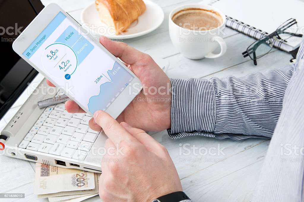 Man is checking data usage on his smartphone stock photo