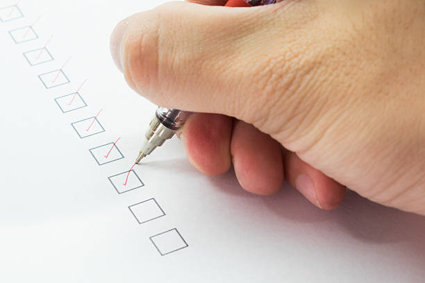 man is checking on list with red pen Closed-up A man is checking on list with red pen anonymous stock pictures, royalty-free photos & images