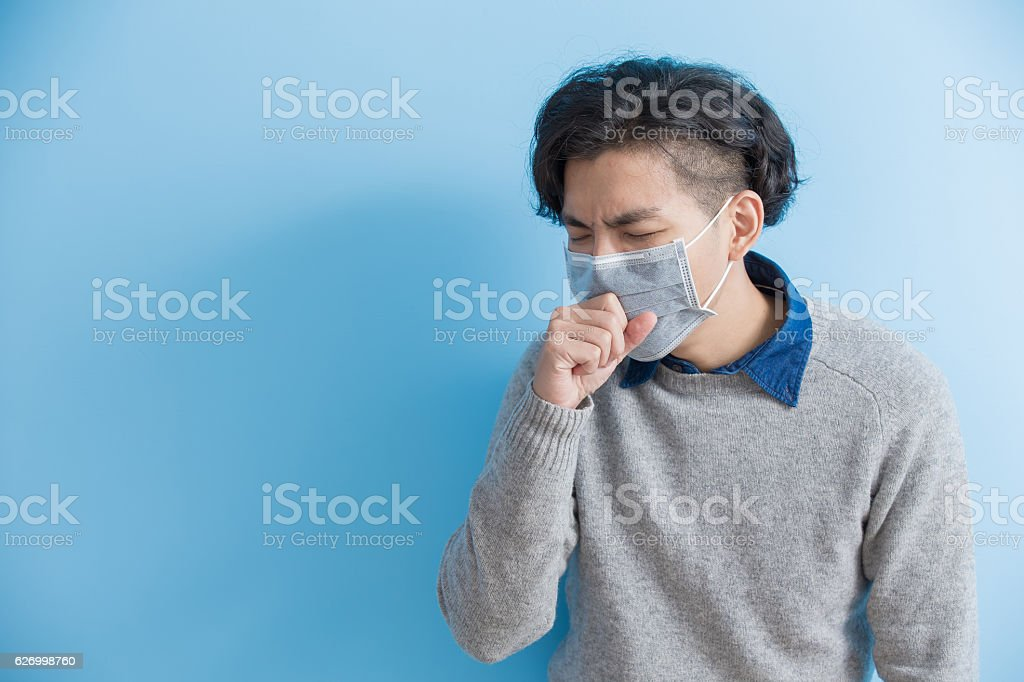 man is coughing stock photo