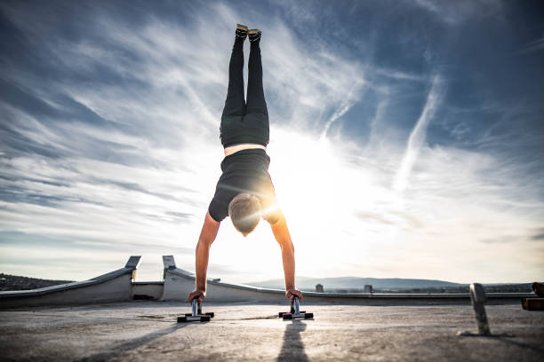Man is doing handstand  on rooftop