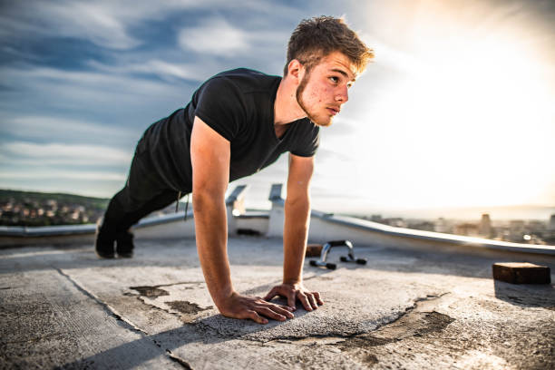 Man is doing push-ups  on rooftop