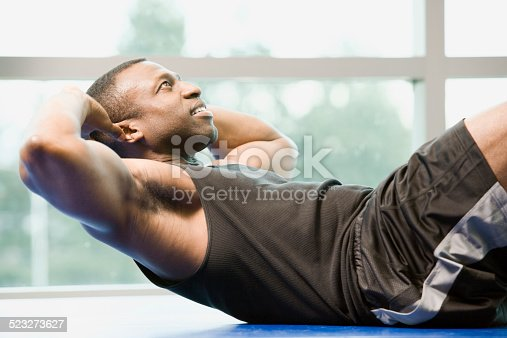 1069872470istockphoto Man Is Doing Sit-Ups At A Gym 523273627