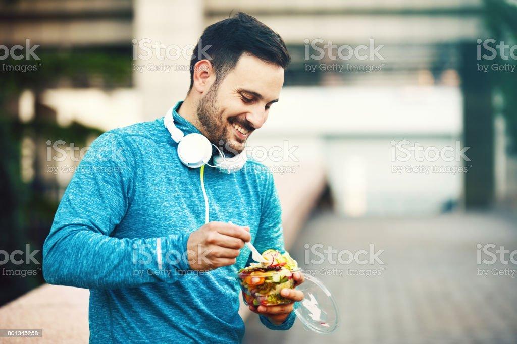 Man is eating fruit salad stock photo