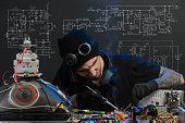 istock man is engaged in repair of electronics 685885256