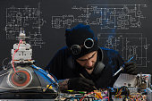 istock man is engaged in repair of electronics 685885296