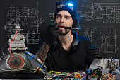 istock man is engaged in repair of electronics 685885348