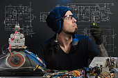 istock man is engaged in repair of electronics 685885570