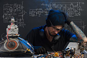 istock man is engaged in repair of electronics 685885786