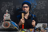 istock man is engaged in repair of electronics 686202498