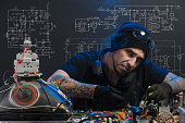 istock man is engaged in repair of electronics 686202710