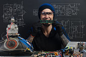istock man is engaged in repair of electronics 686202816