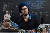 istock man is engaged in repair of electronics 686202980