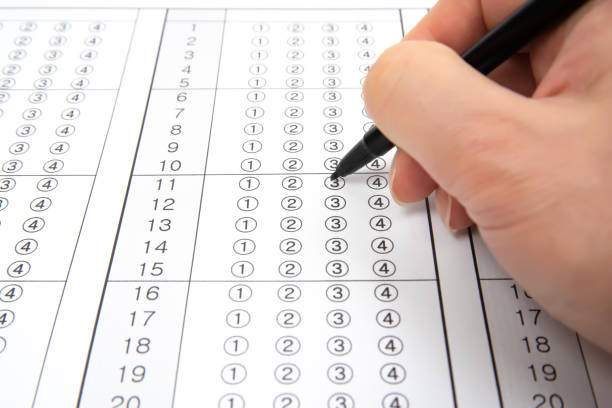 Man is filling OMR sheet handing with pen. stock photo