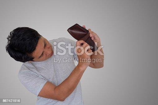 istock Man is finding money in wallet. 867421516