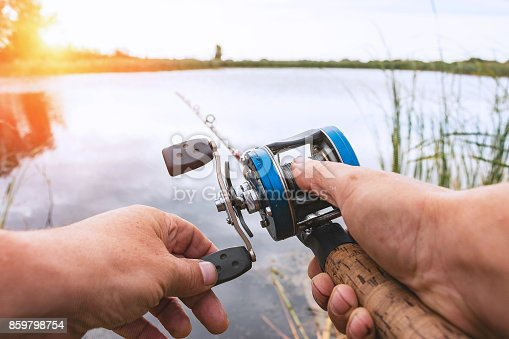 914030378 istock photo Man is fishing with a backcasting reel 859798754