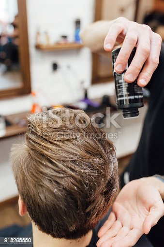 istock man is getting hairstyle at barber shop 918265550
