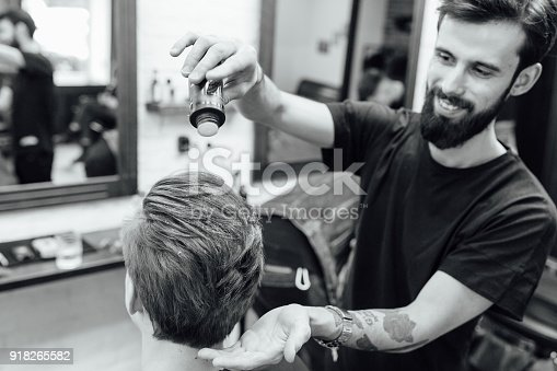 istock man is getting hairstyle at barber shop 918265582
