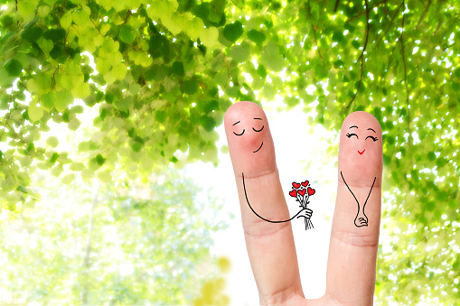 Conceptual family finger art of a Happy couple. Happy Valentine's Day, wedding, 8 March, womans day, mothers day, spring and birthday creative and funny love series. Painted fingers in love concept.