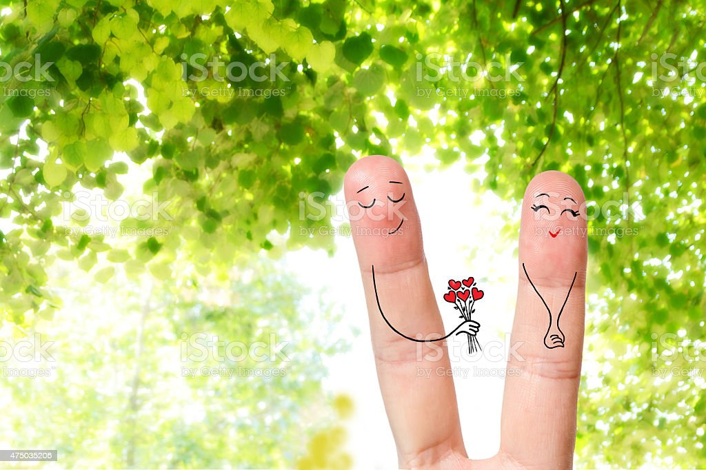 Man is giving a bouquet of red hearts stock photo