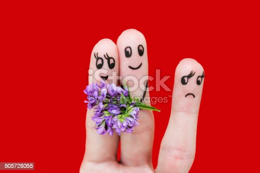 istock Man is giving flowers to a woman. girl is jealous. 505726055