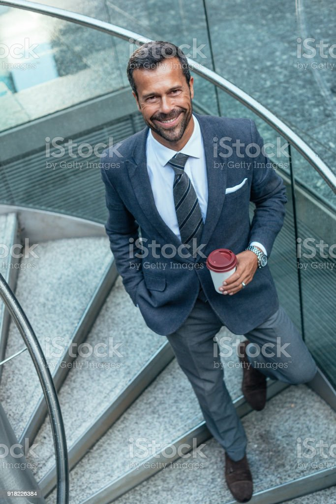 Portrait of business person - mature man in full suit with necktie in...