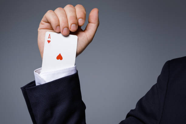 Man is hiding an Ace in the sleeve Gambling addiction concept. Man is hiding an Ace card in the sleeve. magic trick stock pictures, royalty-free photos & images