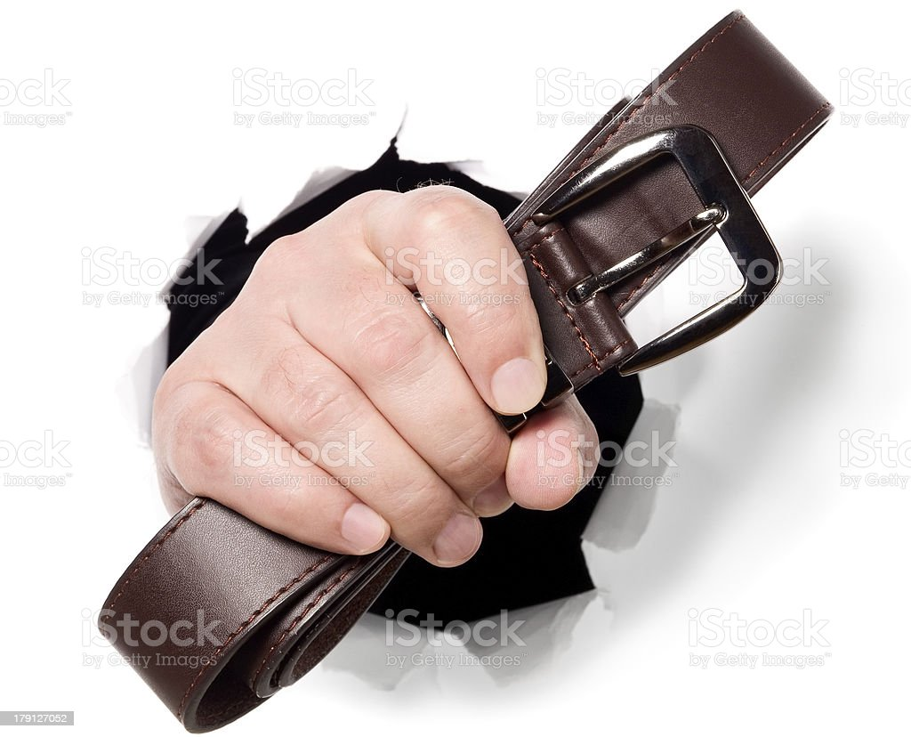 Man is holding belt in his fingers through a hole royalty-free stock photo