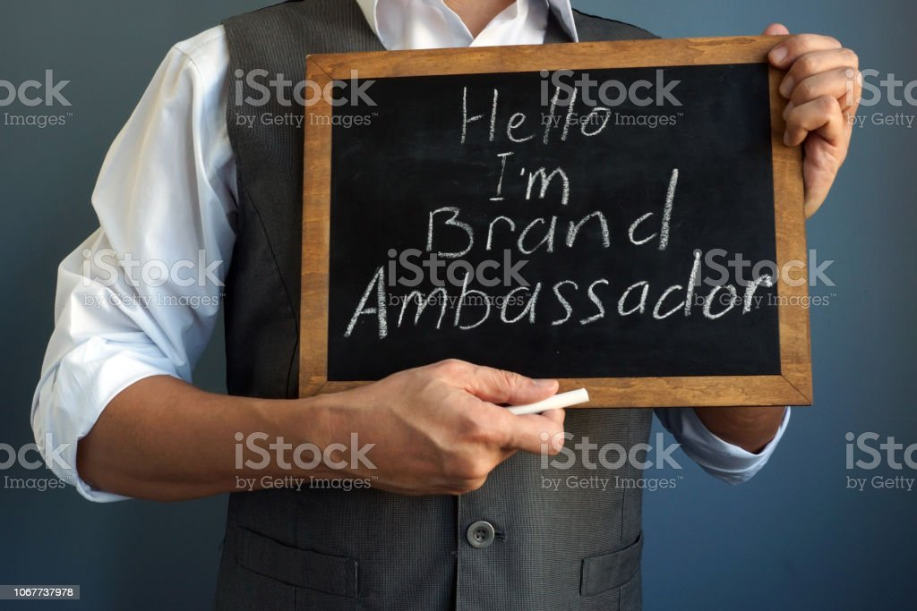 Man is holding blackboard with sign I am Brand Ambassador. stock photo