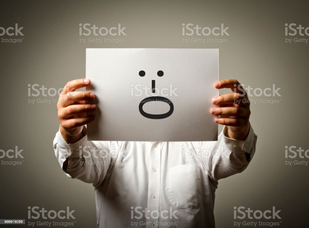 Man is holding white paper with smile. Yell and shout concept. stock photo