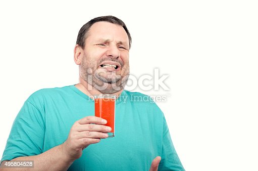istock Man is irritated by detox drink 495804528