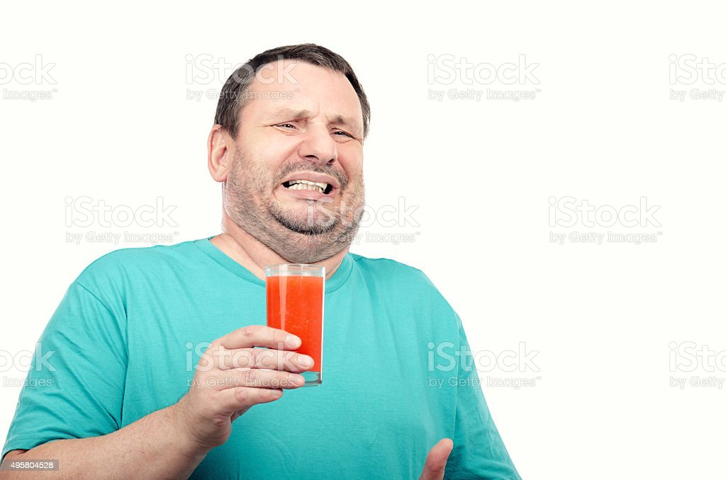 Man is irritated by detox drink stock photo