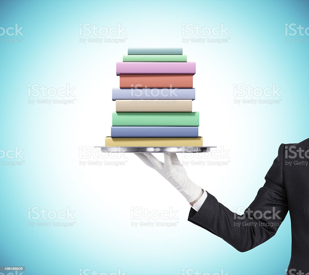 Man is keeping a tray with pack of books stock photo