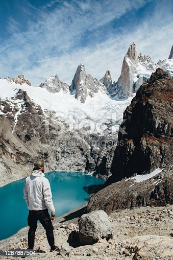 Man is looking at the Laguna Sucia and Cerro Torre near Fitz Roy in Patagonia, Argentina